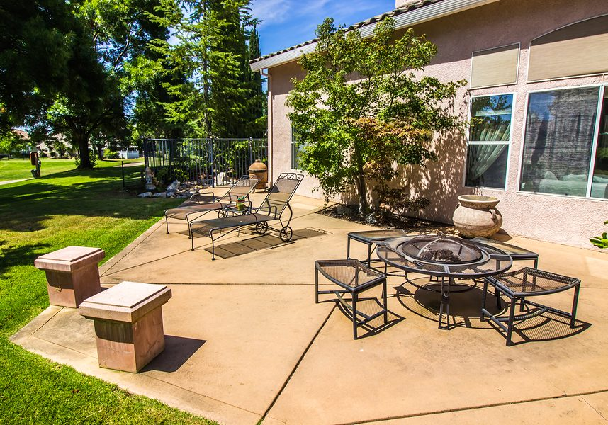 lounge chairs and fire pit in rear yard patio